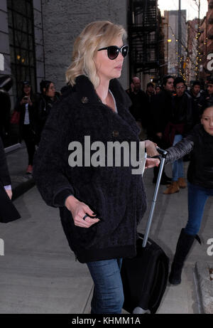 NEW YORK, NY - FEBRUARY 08: Actress Charlize Theron leaves a downtown hotel on February 8, 2017 in New York City. - Stock Photo