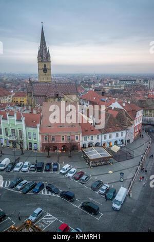 Transylvania, Romania. 17th November, 2017. Sibiu, Romania, 2017 - The Evangelical Church on Huet Square at sunset - Stock Photo