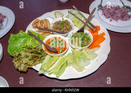 Mixed of Thai Chili Set with Pork Snack and Vegetable for a meal in Northern of Thailand - Stock Photo