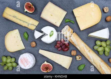 Cheese board platter plate Swiss bread Camembert slate top view from above - Stock Photo