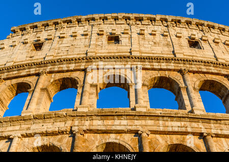 Night view of the Colosseum, an elliptical amphitheatre in the centre of Rome,Italy.Built of concrete and stone,it - Stock Photo