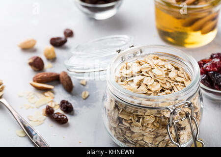 Ingredients for homemade oatmeal granola - Stock Photo