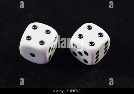 A pair white of dice showing Double Four - Stock Photo