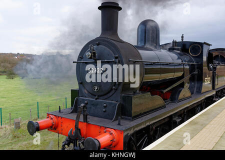 Steam train, black 0 6 0 locomotive waiting to depart from burrs country park railway station bury lancashire uk - Stock Photo