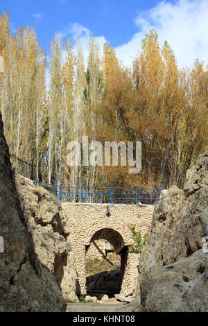 Stone bridge and trees at autumn near Maalula, Syria - Stock Photo