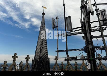 The radio antenna and communication mast on the the roof of Lincoln Cathedral - Stock Photo