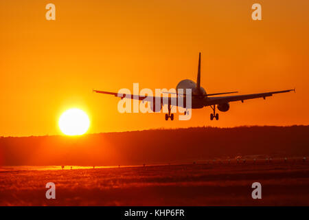 Airplane airport aviation sun sunset vacation holidays travel traveling plane aircraft travelling - Stock Photo
