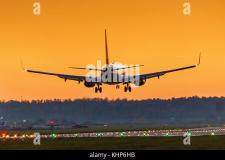 Airplane landing Stuttgart airport sun sunset vacation holidays travel traveling plane aircraft travelling - Stock Photo