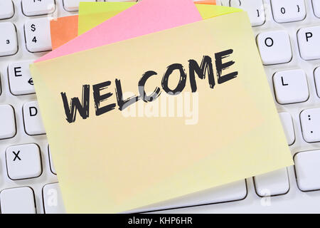 Welcome new employee colleague refugees refugee immigrants note paper business concept keyboard - Stock Photo
