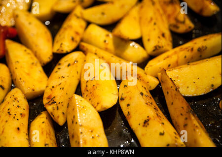 Prepared Potatoes for Baked Potatoes - oiled, seasoned and salted, ready for the Oven! - Stock Photo