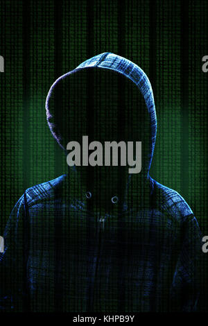 Unknown computer hacker with hood against background data and dramatic lighting with copy space. Concept of cybercrime. - Stock Photo