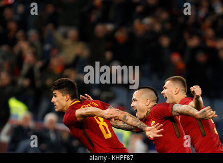 Rome, Italy. 18th Nov, 2017. Roma s Diego Perotti, left, celebrates with his teammates Radja Nainggolan, center, - Stock Photo