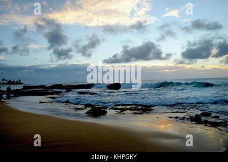 Sunrise over Sandy Beach - Oahu, Hawaii - Stock Photo
