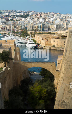Looking over The Great Siege Road, Valletta, and Marsamxett Harbour, towards Manoel Island and Manoel Yacht Marina, - Stock Photo