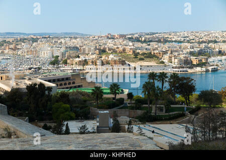 Looking over the Great Siege Road, Valletta, & Marsamxett Harbour, to Ta' Xbiex in the distance, centre of photograph, - Stock Photo