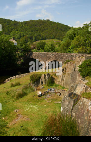 Arched stone bridge over river valley, Lake District National Park, Cumbria, UK - Stock Photo