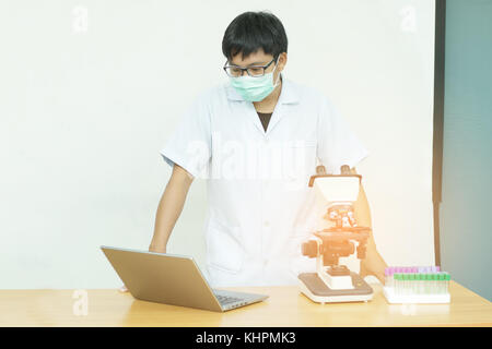 Equipment for research experiments in science laboratory, Microscopy and empty vacuum blood tube,microscope in medical - Stock Photo