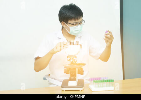 Equipment for research experiments in science laboratory, Microscopy and empty vacuum blood tube,microscope in medical laboratory,Scientists are exper
