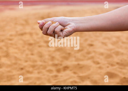 Sand in man's hand blur background select focus - Stock Photo