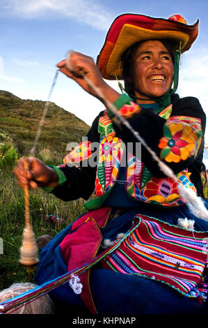 Village of Llachón, Capachica Peninsula, near Puno, Peru. A woman from the village of Llachón dressed in a typical - Stock Photo