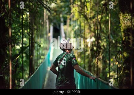 Sky walk in Arenal Costa Rica Central America. Suspended bridge at natural rainforest park, Costa Rica. - Stock Photo