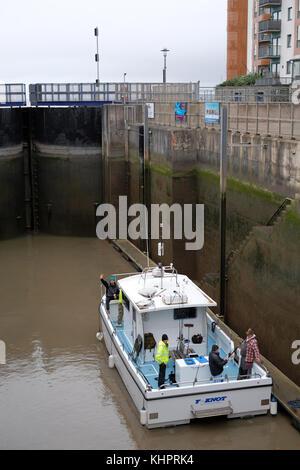 November 2017 - Leaving in the lock, boat of rod and line fisherman leaving Portishead Marina via the lock gates. - Stock Photo