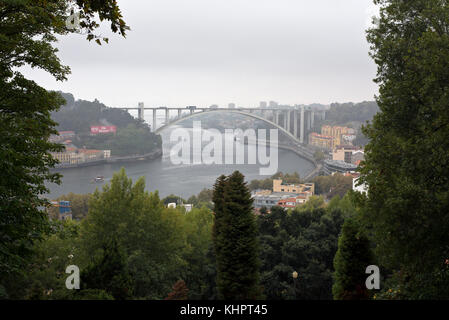 View from the Garden Of The Crystal Palace looking west across the river Douro towards the Ponte da Arrábida bridge - Stock Photo