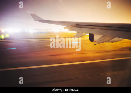 The window view from an Airbus A340-300 of Air France, departing Bogota El Dorado international airport at night - Stock Photo