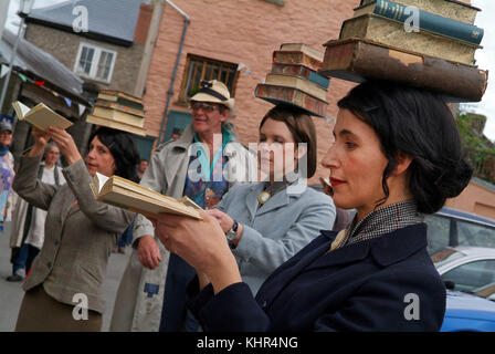 Hay Festival in Hay-on-Wye with street performers with books on their heads, bookshops, deckchairs etc. - Stock Photo