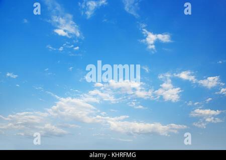 White cirrus clouds in bright blue sky. - Stock Photo