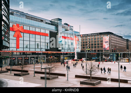 Helsinki, Finland - December 7, 2016: People Walking Near Original Sokos Hotel Presidentti And Kamppi Shopping Centre. - Stock Photo