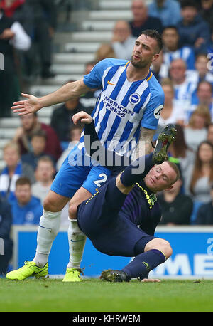 Everton's Wayne Rooney grapples with Shane Duffy of Brighton during the Premier League match between Brighton and - Stock Photo