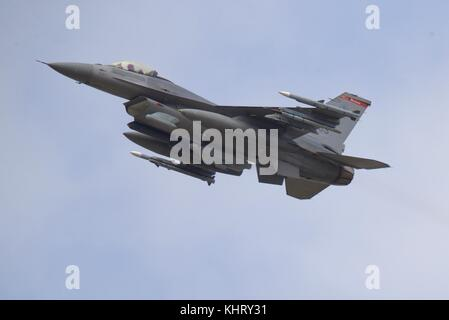 Lockheed Martin F-16C Fighting Falcon from 480th Fighter Squadron performing a flypast marking the US Air Force - Stock Photo