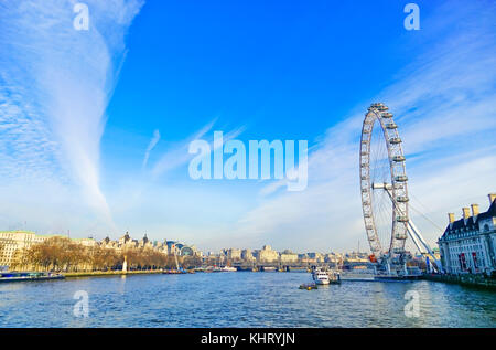 View of the River Thames with London Eye in a sunny day - Stock Photo