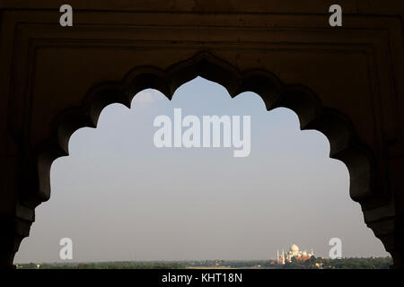 View of Taj Mahal trough an ornated window arch at Red Fort, framed and negative space around it. Agra, Uttar Pradesh, - Stock Photo