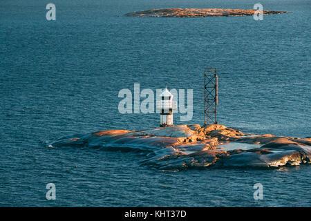 Helsinki, Finland. Lighthouse On Stone Island In Archipelago Near Helsinki. - Stock Photo