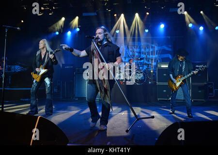 POMPANO BEACH FL - FEBRUARY 10: Rickey Medlocke, Johnny Van Zant, Gary Rossington of Lynyrd Skynyrd performs at - Stock Photo