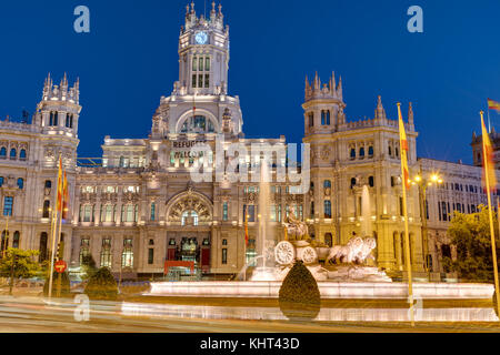 Plaza de Cibeles in Madrid with the Palace of Communication at night - Stock Photo