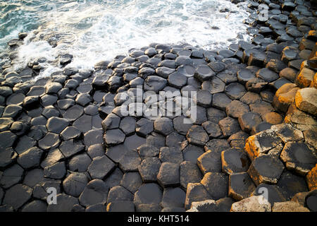 black hexagonal basalt rocks at Giants Causeway county antrim northern ireland uk - Stock Photo