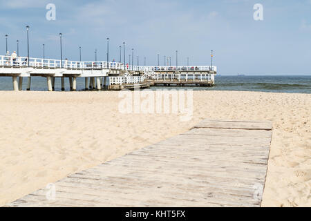 View of the Brzezno Pier and Beach in Gdansk, Poland, on a sunny day in the autumn. - Stock Photo
