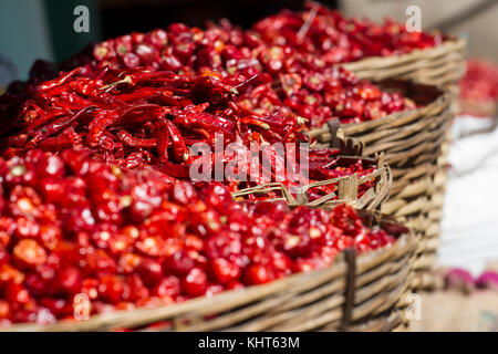 Dried Chili Peppers Bamboo Basket on wooden table,close up dried chili in basket close up red dried chili,Dried - Stock Photo
