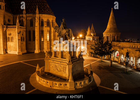 City of Budapest in Hungary at night, King St. Stephen (1906) monument, Matthias Church and Fisherman Bastion, Holy - Stock Photo