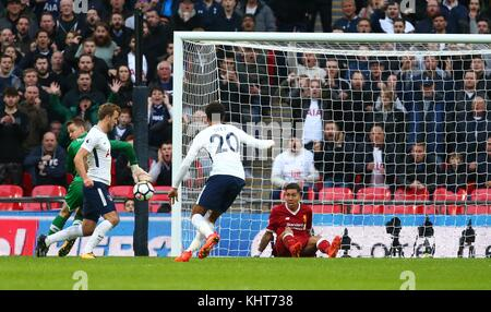 Harry Kane of Tottenham scores during the Premier League match between Tottenham Hotspur and Liverpool at Wembley Stadium in London. 22 Oct 2017 *** EDITORIAL USE ONLY *** No merchandising. For Football images FA and Premier League restrictions apply inc. no internet/mobile usage without FAPL license - for details contact Football Dataco