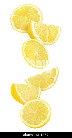 Isolated lemon slices in the air. Cut lemon fruit falling isolated on white background with clipping path - Stock Photo