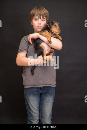 Happy boy portrait, boy and dog in love. Friends having fun whilst posing. Young little cute adorable kid and his - Stock Photo
