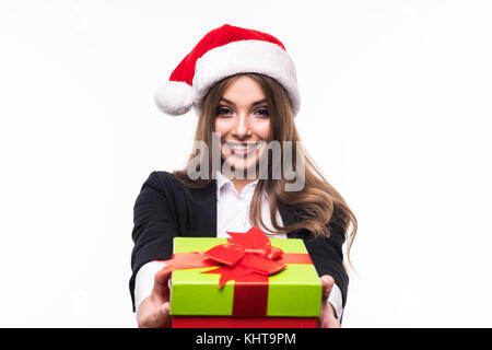 Businesswoman wearing Santa hat holding red gift box. Isolated portrait. - Stock Photo