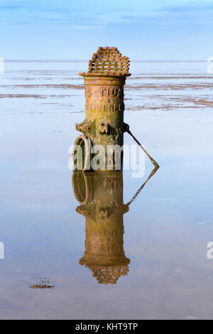 The cast iron structure is a ventilation shaft on the old sewer discharge pipe on Southport beach in Merseyside. - Stock Photo
