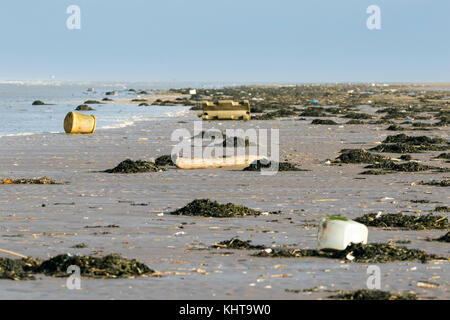 Beach debris washed up onto Southport beach in Merseyside - Stock Photo