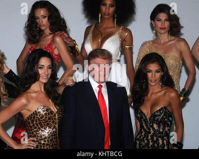 Angela Martini, Donald Trump, Riyo Mori Donald Trump poses with ...