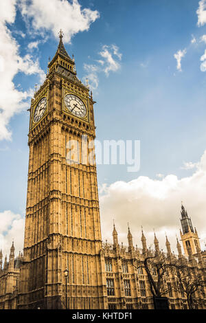 Big Ben tower in central London, wide angle shot from below looking up into the sky. - Stock Photo